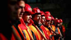 Workers chant slogans during a protest in central Athens on Thursday, Dec. 17, 2009