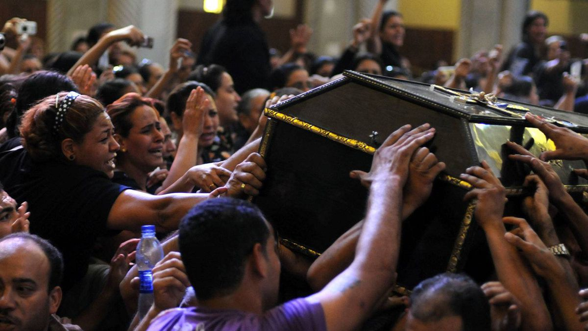 Egyptian Copts mourn over the coffin of a victim of deadly clashes, during a funeral at Abassaiya Cathedral in Cairo on October 10, 2011, a day after 24 people, mostly Christians, died in clashes with Egyptian security forces.