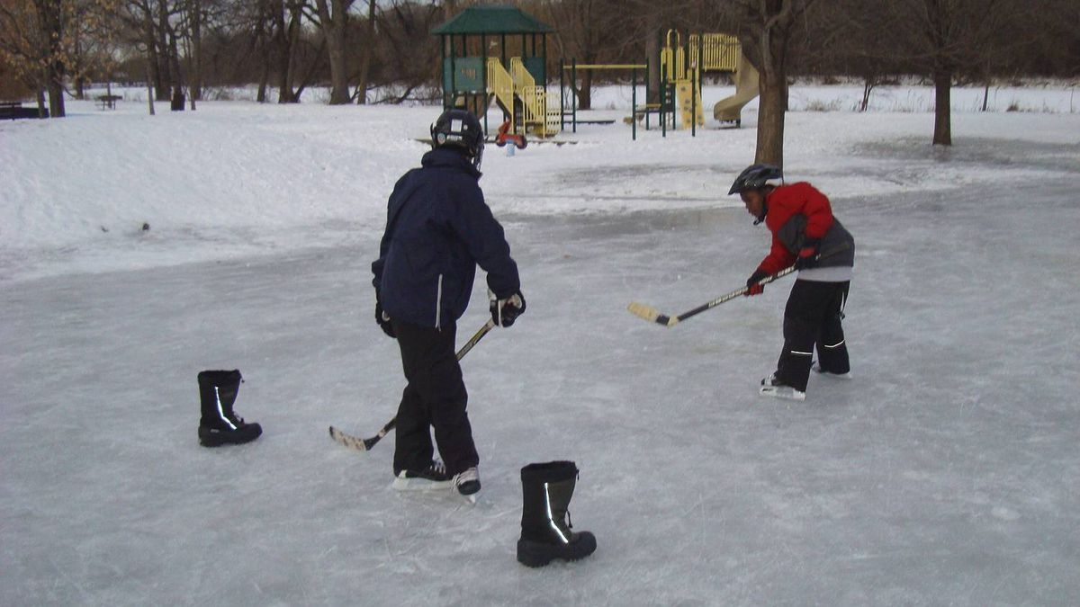 Heather Johnston photo: First winter in Canada... There is always hockey at our great neighbourhood rink in Ottawa.