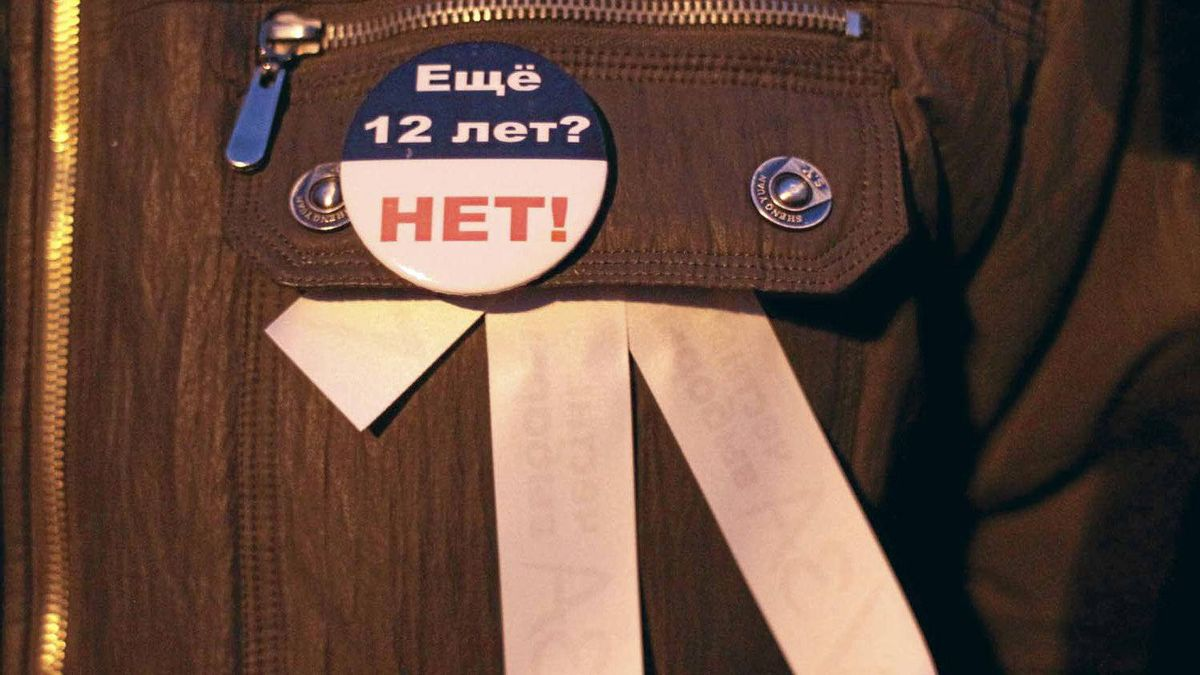"""A participant wears a badge saying """"12 more years? No!"""" during a protest demanding fair elections in central Moscow on March 5, 2012."""