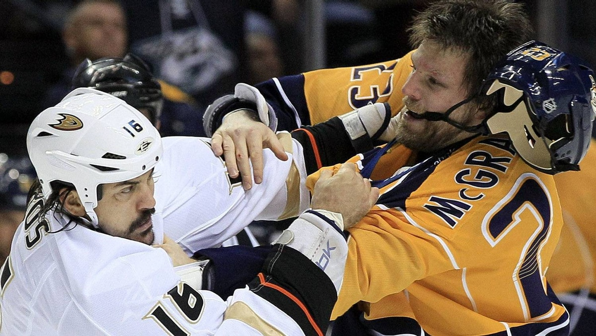 Anaheim Ducks right wing George Parros (16) fights with Nashville Predators forward Brian McGrattan (23) in the first period of an NHL hockey game on Saturday, Dec. 10, 2011, in Nashville, Tenn. The Predators won 3-2. (AP Photo/Mark Humphrey)