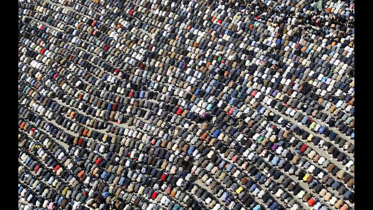 Anti-government protesters take part in Friday prayers at Tahrir Square in Cairo February 4, 2011.