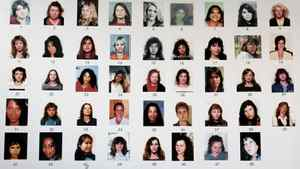 Detail of a posterboard of 48 missing women connected with the Robert Pickton serial killer case..