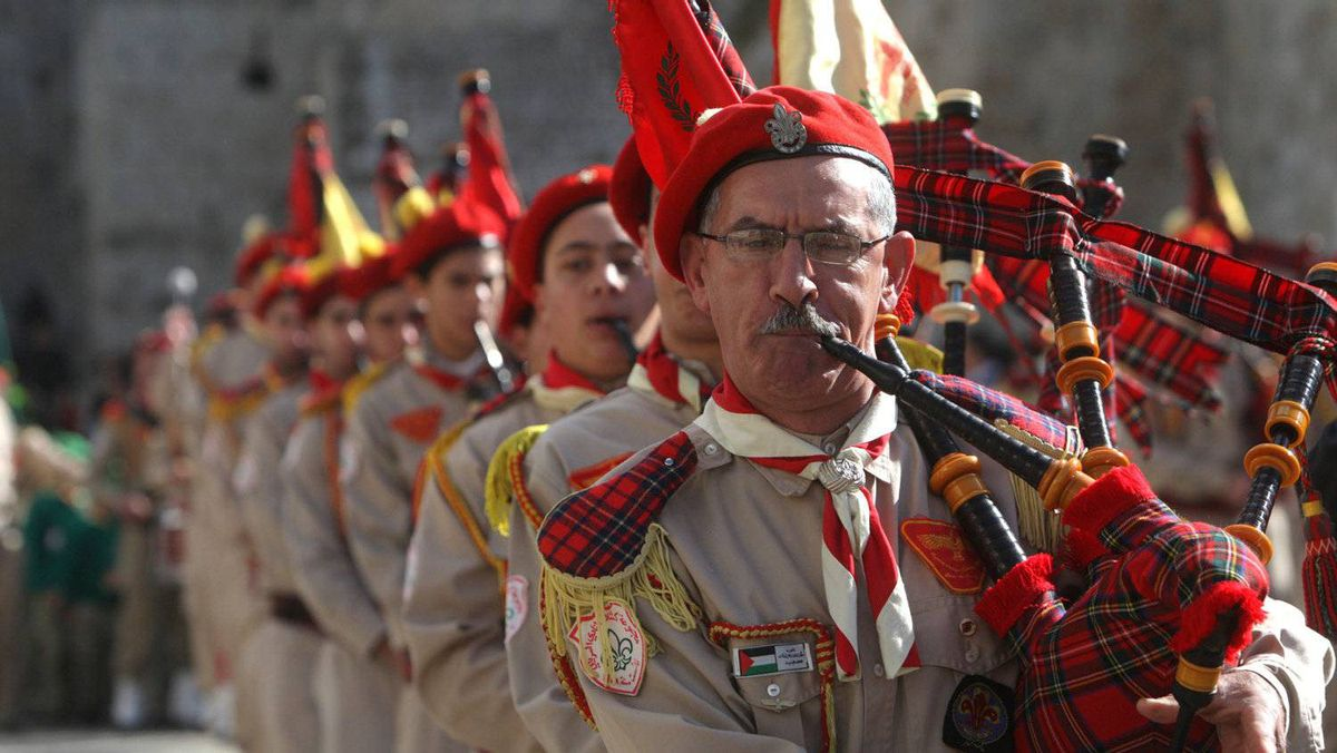 Palestinian Scouts play the bagpipes outside the Church of the Nativity while Christians gather for Christmas celebrations in the West Bank city of Bethlehem on December 24, 2011, as thousands of Christian pilgrims descended on Bethlehem to celebrate in Jesus' traditional birthplace.