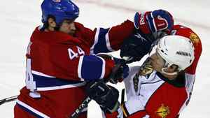 Montreal Canadiens defenseman Roman Hamrlik (L) hits Florida Panthers left wing David Booth during the second period of their NHL hockey game in Montreal February 2, 2011. REUTERS/Shaun Best