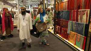 Delegates and shoppers look at stalls during an exhibition called 'Lifestyle Pakistan' in New Delhi, India, Thursday, April 12, 2012. The four-day exhibition, in which over 100 Pakistani lifestyle companies will showcase their products and services, was inaugurated Thursday.