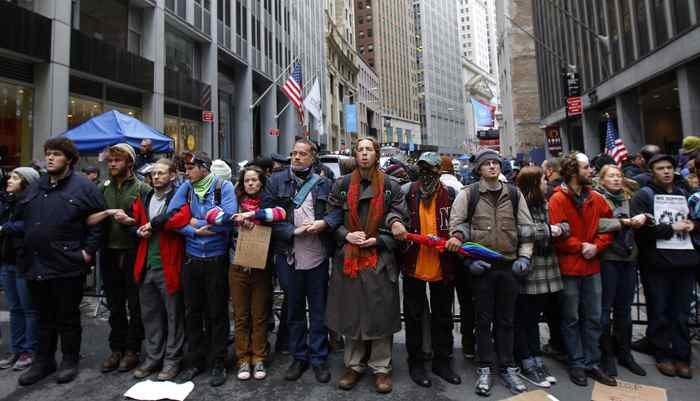 "Occupy Wall Street demonstrators lock arms as they block Broad Street near the New York Stock Exchange during what protest organizers call a ""Day of Action"" in New York November 17, 2011."