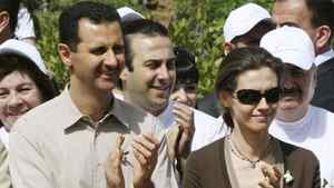 Syrian President Bashar al-Assad and his wife Asma visit an environmental garden during the opening of the Jasmine Festival, in central Damascus, in 2007.