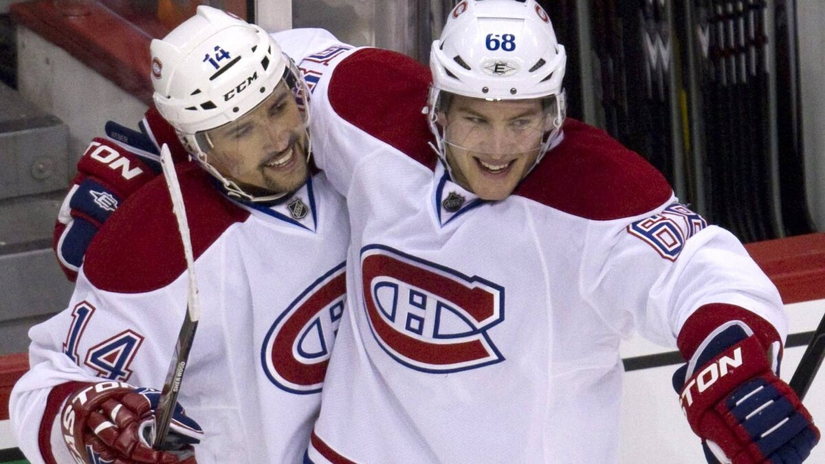 Montreal Canadiens center Tomas Plekanec (14) celebrates his goal with teammate defenseman Yannick Weber (68) during second period NHL hockey action in the Winnipeg Jets inaugural game at the MTS Centre in Winnipeg, Sunday, Oct. 9, 2011. THE CANADIAN PRESS/Jonathan Hayward