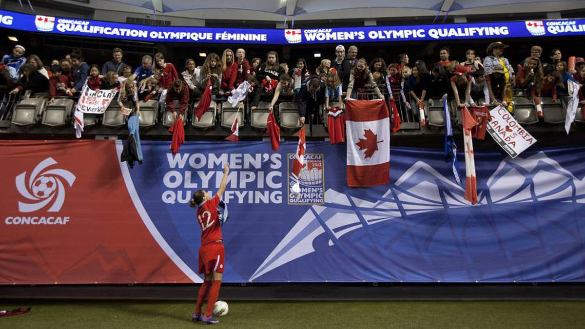 Canada's Christine Sinclair signs autographs for fans following her teams 4-0 loss to the United States at the CONCACAF women's Olympic qualifying final soccer action at B.C. Place.