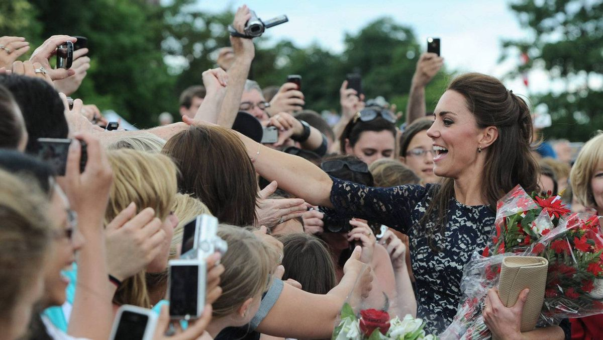 Duchess of Cambridge shakes hands as she greets the crowds as she and Prince William take part in a ceremony at the National War Memorial in Ottawa on Thursday, June 30, 2011
