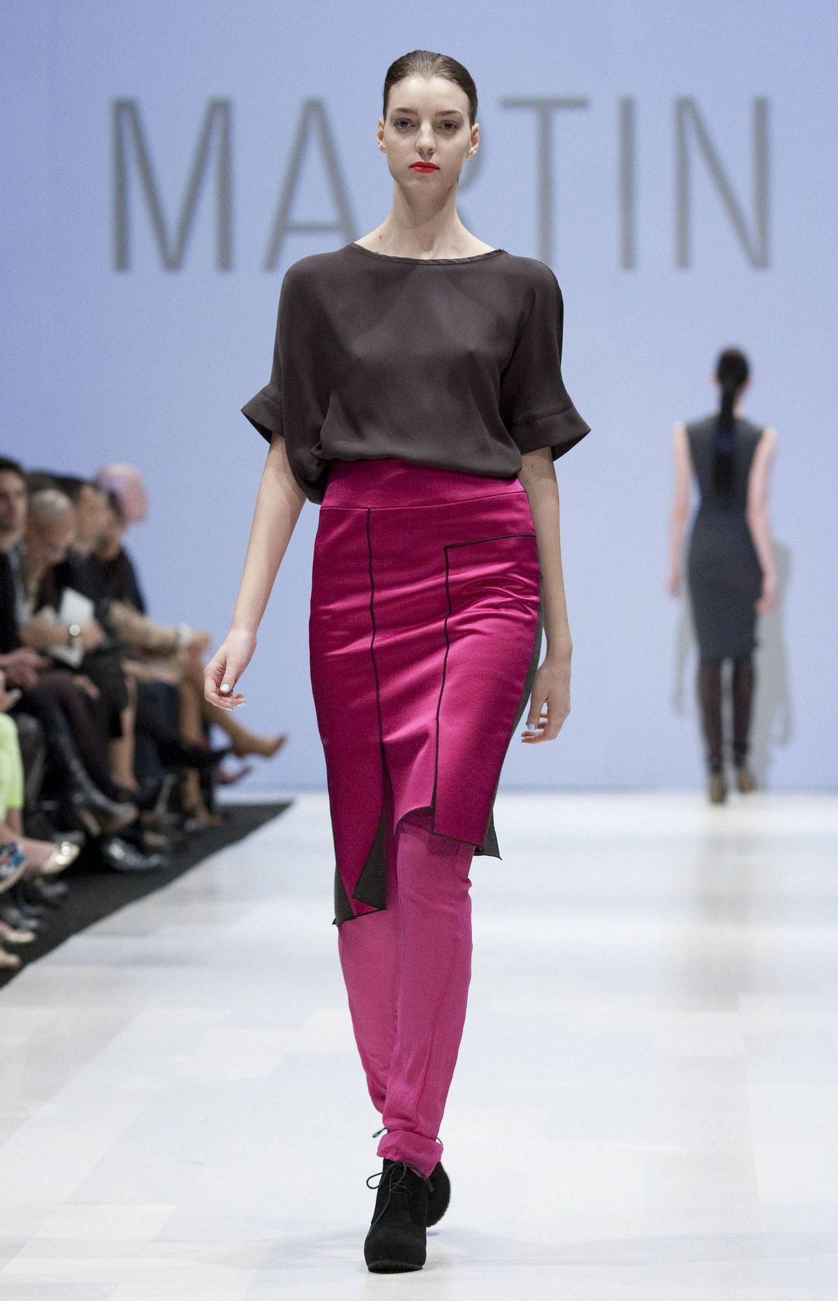 Long strips of silk and satin were used throughout, often to great effect on tunics and shifts that gave shape and sensual movement. But on the boxy tees and scarves, the effect was less than flattering.