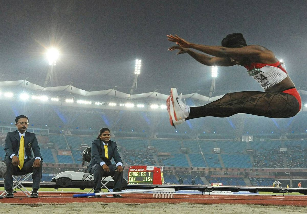 Canada's Tabia Charles competes with lace stockings during the women's triple jump final event of the Track and Field competition of the XIX Commonwealth games on October 8, 2010 in New Delhi.