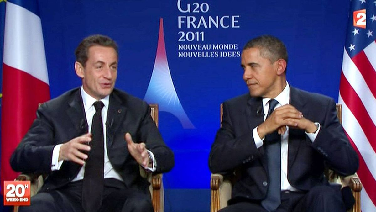 A TV grab made from French TV channel France 2 on November 4, 2011 shows US president Barack Obama (R) listening to his French counterpart Nicolas Sarkozy during their joint appearance for a pre-recorded interview at the end of the G20 meeting of Cannes.