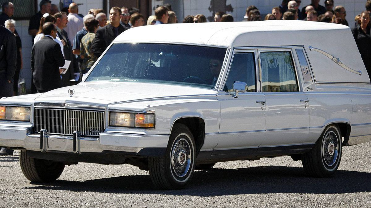 The hearse carrying Winnipeg Jets player Rick Rypien leaves his funeral service. THE CANADIAN PRESS/Jeff McIntosh