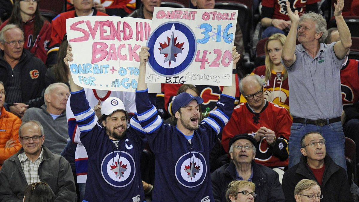 Winnipeg Jets fans cheer for their team in Calgary, March 9, 2012. The last time the Jets played in Calgary was April 28, 1996.