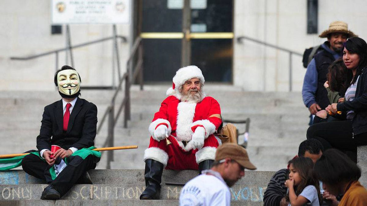 Santa Claus sits on the steps to City Hall in Los Angeles, overlooking where anti-Wall Street demonstrators camped out.