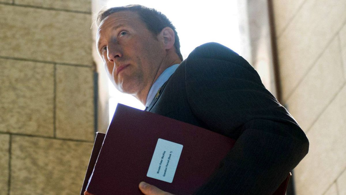 Defence Minister Peter MacKay makes leaves the foyer of the House of Commons on June 14, 2011.