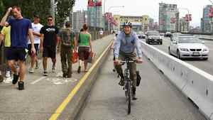 Vancouver mayor Gregor Robertson rides his bike in the newly designated bicycle lane on the Burrard Street Bridge in Vancouver July 12, 2009.