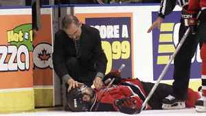 New Jersey Devils Scott Niedermayer lies on the ice after he was injured in the closing seconds of their game with the Toronto Maple Leafs, May 3, 2001. Niedermayer was knocked down by Toronto Maple Leafs Tie Domi who was given a five minute penalty with the intent to injure.