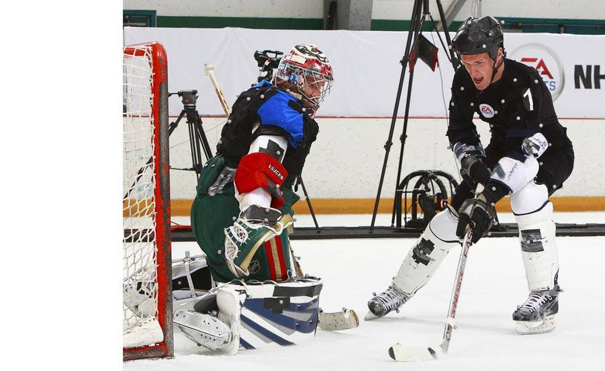 Calgary Flames' Dion Phaneuf takes a shot on Minnesota Wild goaltender Josh Harding during a motion capture session in Burnaby, B.C., September 9, 2008. The NHL 09 video game was launched today and motion capture of six NHL hockey players was done on the ice surface by Electronic Arts staff. Jeff Vinnick-Electronic Arts