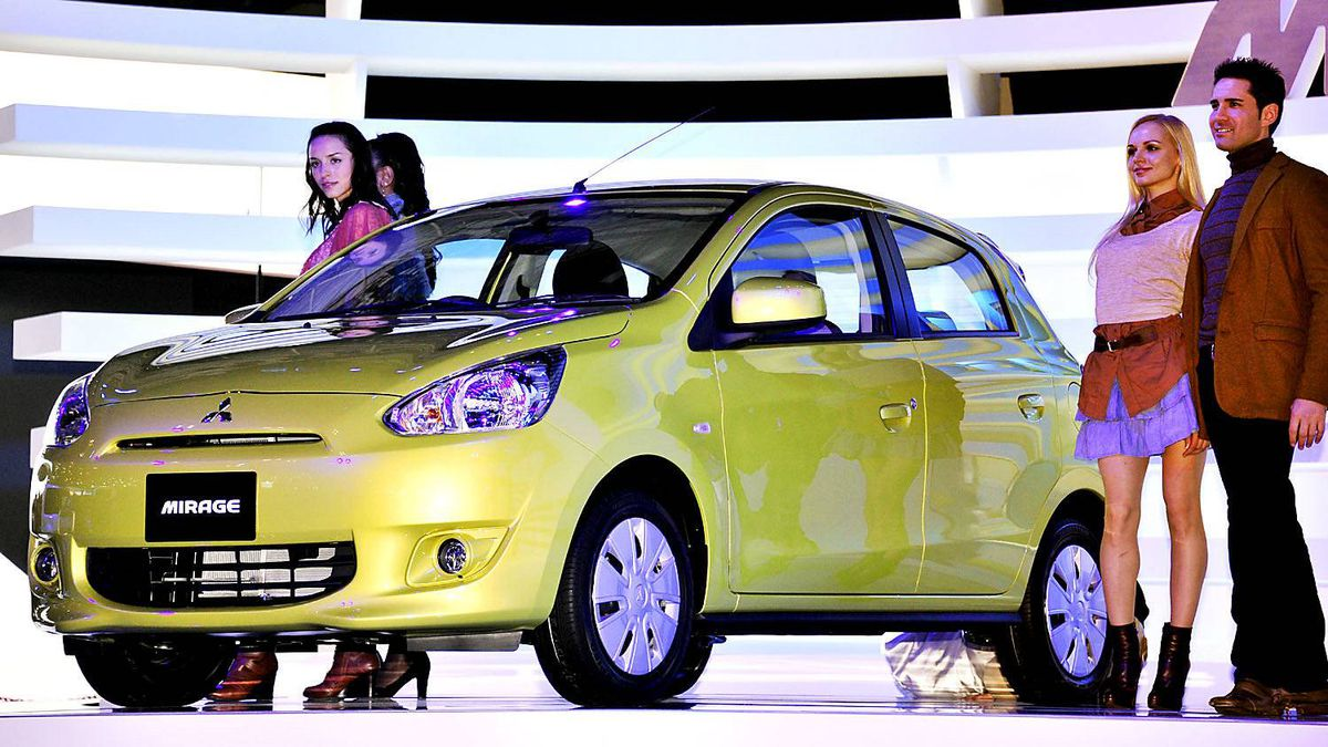 Mitsubishi Mirage, a emission compact vehicle with a 1-litre engine. Energy-saving electric cars with advanced green technology were vying for attention as the Tokyo Motor Show opened with robots and computers becoming ever more part of the vehicles on display.
