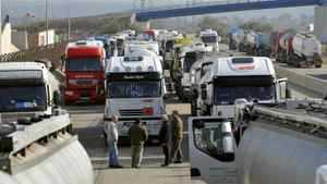 Tankers are blocked by on strike workers at the entrance of Fos-sur-Mer's oil terminal, on October 14, 2010 in Fos-sur-Mer.