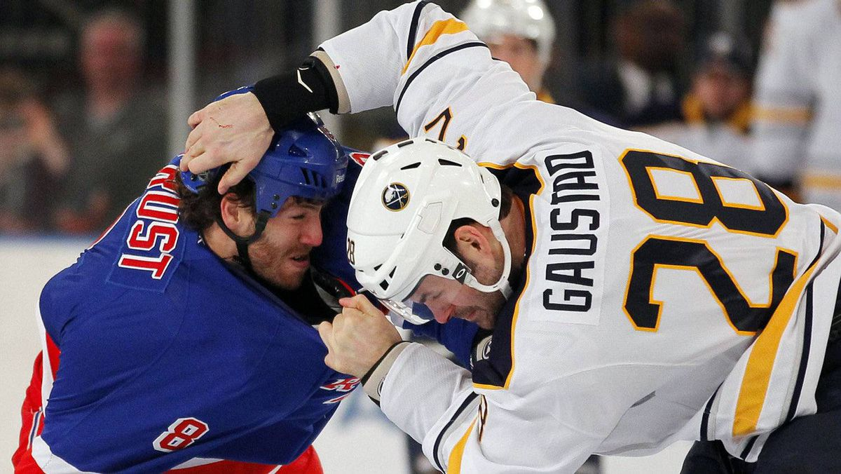New York Rangers right wing Brandon Prust fights with Buffalo Sabres center Paul Gaustad in first period action during their NHL hockey game at Madison Square Garden in New York, February 25, 2012. The Rangers won 3-2. REUTERS/Adam Hunger