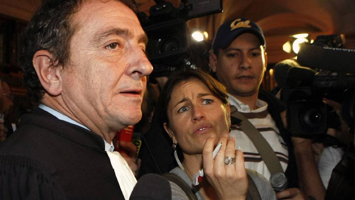 Church of Scientology lawyer Patrick Maisonneuve, left, speaks to reporters after a court returned a verdict of fraud against the group, at a Paris courthouse, Tuesday, Oct. 27, 2009.
