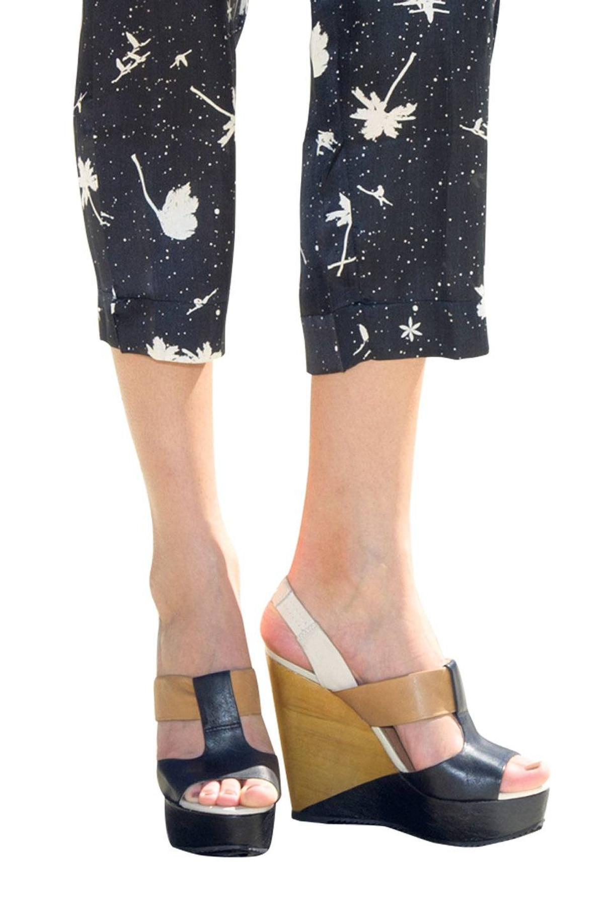 For extra edge, look for wedges with a colour-block effect. Aldo wedges, $110. Surface to Air jumpsuit, $550 at the Bay.