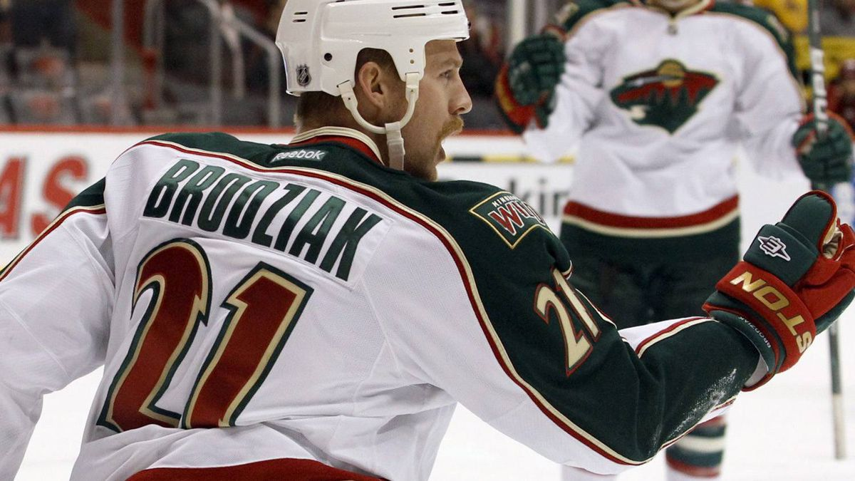 Minnesota Wild center Kyle Brodziak celebrates his goal against the Phoenix Coyotes in the first period of an NHL hockey game, Saturday, Dec. 10, 2011, in Glendale, Ariz. (AP Photo/Paul Connors)