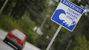 An April 2007) file photo shows a tsunami hazard warning sign located west of Sooke, B.C.