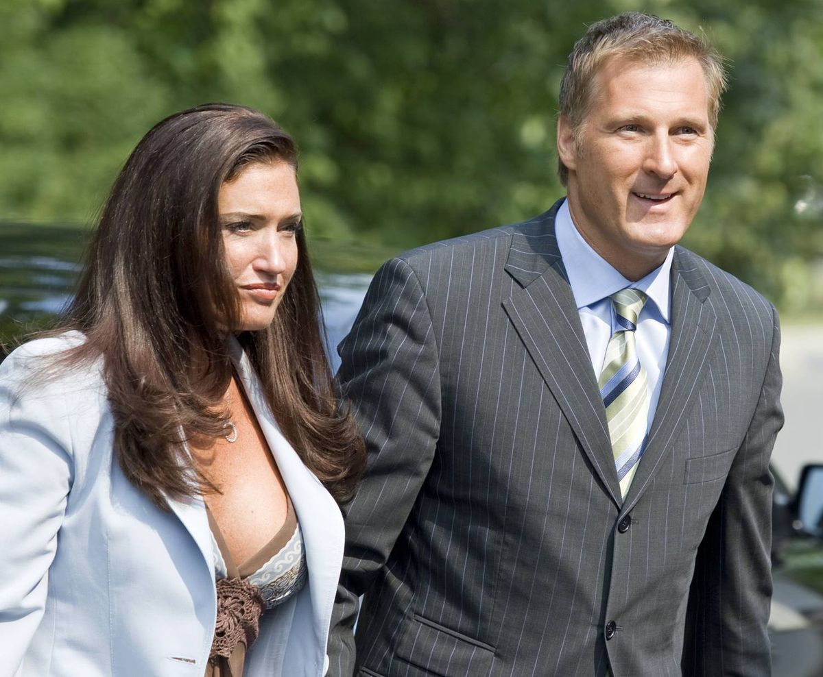 Maxime Bernier arrives at Rideau Hall to be sworn in as foreign affairs minister accompanied by his girlfriend, Julie Couillard, on Aug. 14, 2007.
