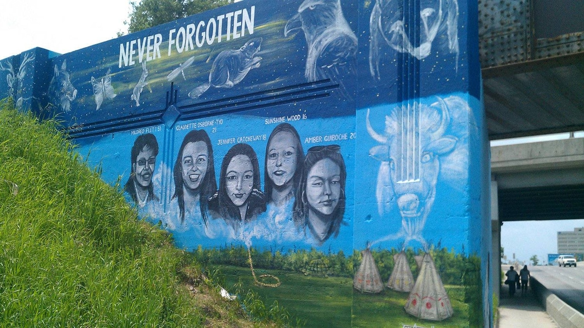 A mural on Portage Avenue in Winnipeg shows the faces of missing and murdered aboriginal women, as created by artist Tom Andrich.