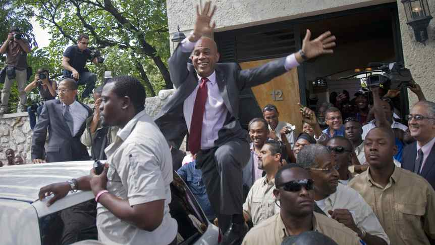 Haiti's presidential candidate Michel 'Sweet Micky' Martelly greets supporters after giving a press conference in Port-au-Prince, April 5, 2011.