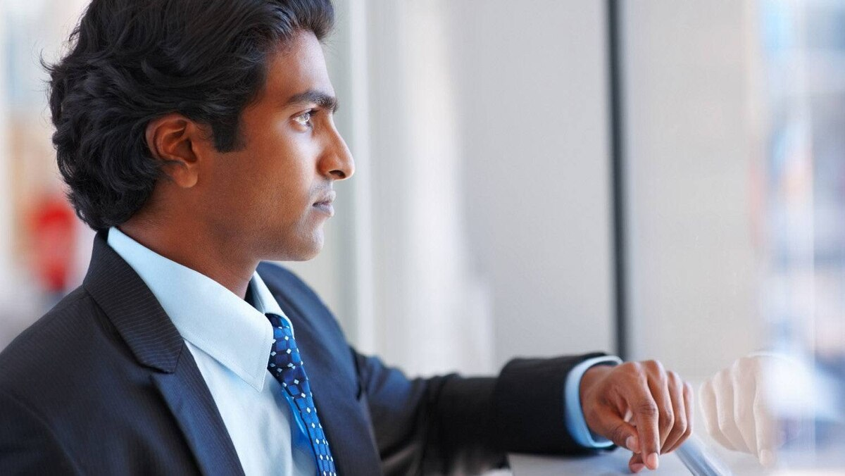 A young Indian business man lost in thoughts