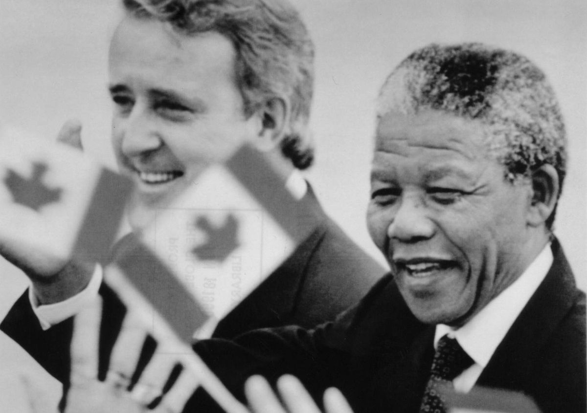 Nelson Mandela and Prime Minister Brian Mulroney make their way through a crowd of onlookers after the South African leader's arrival in Ottawa on June 17, 1990.