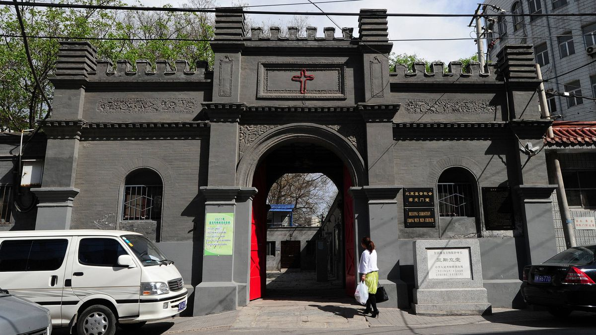 A woman walks to a Christian church on April 17, 2011 in Beijing. Police have rounded up dozens of followers of an underground Protestant church, a rights group said, as a widening crackdown on dissent appeared to spread to religious figures.