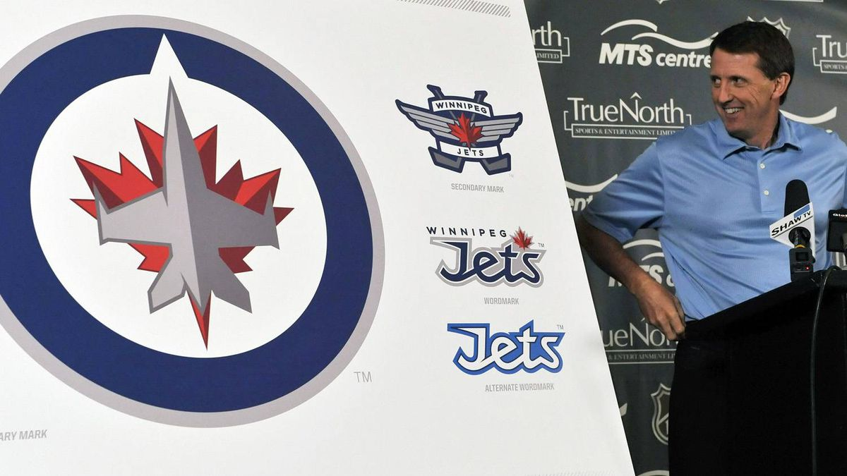 Winnipeg Jets owner Mark Chipman looks at the NHL team's new logo at a news conference in Winnipeg, July 22, 2011. REUTERS/Fred Greenslade