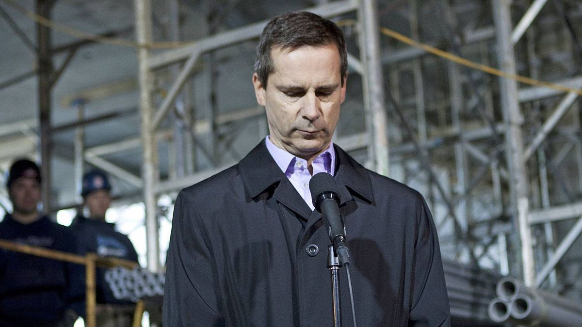 Ontario Premier Dalton McGuinty takes questions from reporters in at a Toronto construction site on March 7, 2012.