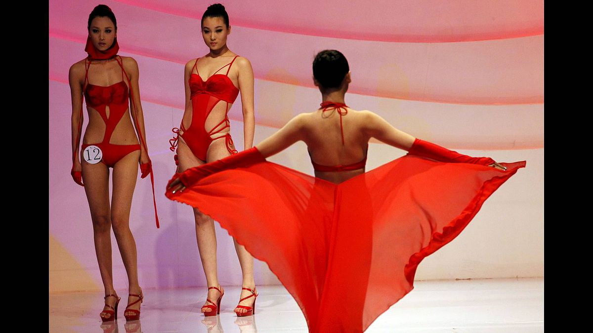 Chinese models show off swimwear during the 7th Hosa Cup China Swimwear Design contest and Hosa Swimwear Trend fashion show held in Beijing, China, Monday, March 28, 2011.