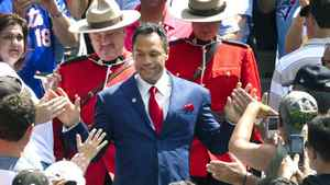 Roberto Alomar comes onto the field for a ceremony to retire his number 12 jersey. REUTERS/Fred Thornhill