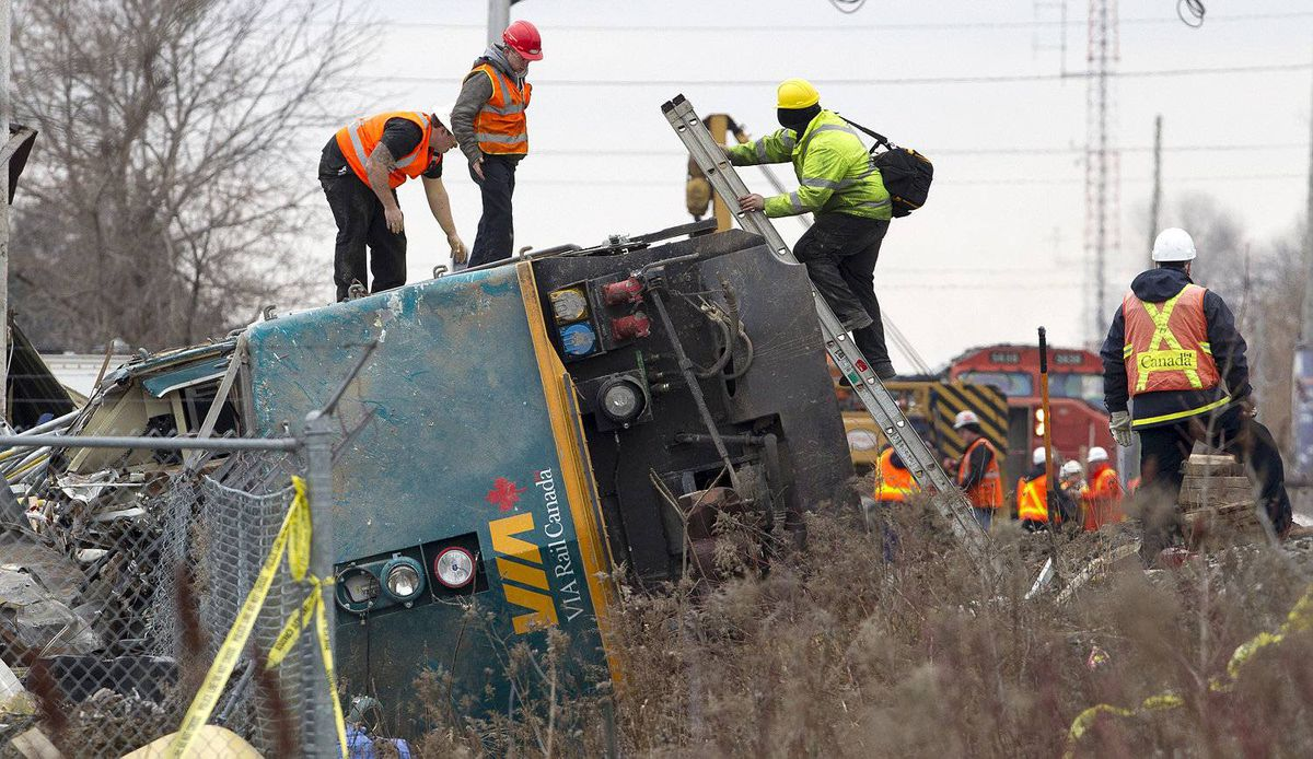 BURLINGTON, ONT. - Feb. 28, 2012 - The VIA locomotive is all that is left to be removed from the derailment scene in Burlington on Feb. 28, 2012. Only one track remains closed while the work is being done, and the locomotive is expected to be removed by early on Tuesday afternoon. The Via passenger train, enroute from Niagara Falls to Toronto, derailed on Sunday at approximately 3:30pm. Three VIA employees in the engine died as a result if the crash, and many passengers were taken to local hospitals; three with serious injuries. One track has been open and trains have been passing the site all day. (Photo by Peter Power/The Globe and Mail)pmp