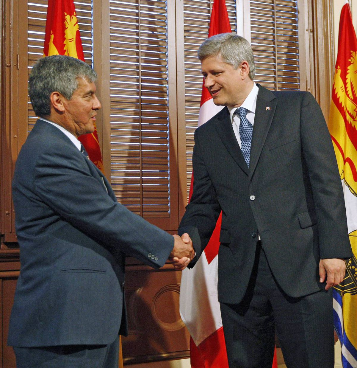 Stephen Harper shakes hands with New Brunswick's incoming lieutenant-governor, Graydon Nicholas, during a meeting in the Prime Minister's Langevin Block office. Mr. Harper also named a new chief justice of the Federal Court of Appeal on Sept. 10, 2009.