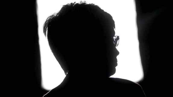 Interim New Democratic Party leader Nycole Turmel is silhouetted against a television light during a news conference in Ottawa on Aug. 23, 2011.