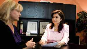 Tina Tehranchian, (R) Financial Planner meets with her client , Anna Zsolnay (L).