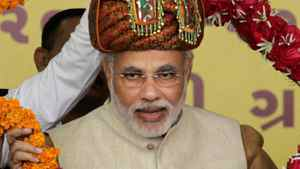 Gujarat Chief Minister Narendra Modi accepts a garland during a ceremony on Jan. 20, 2012.