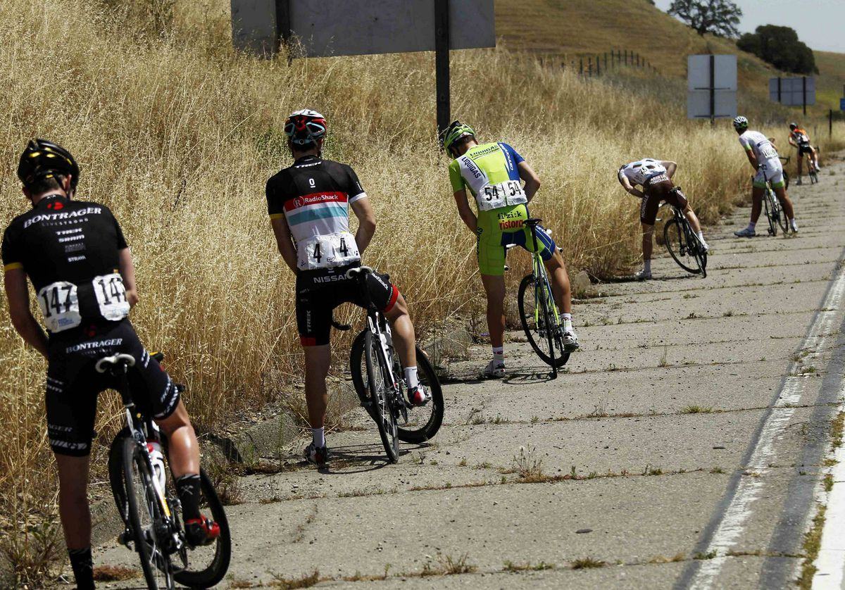 Riders in the peloton stop for a break during Stage 3 of the Tour of California in Tracy, California.