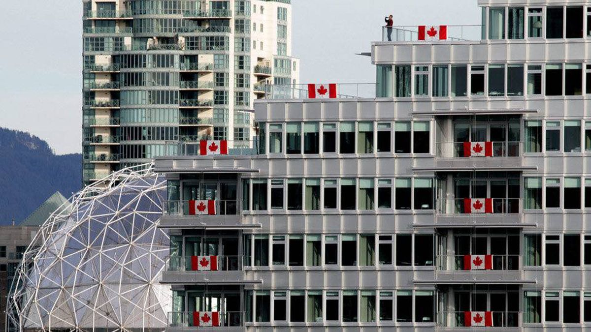 The Olympic Village lined with Canadian flags in Vancouver, B.C., on Thursday February 4, 2010.