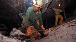 Miners work underground at the Harmony Goldmine, near Carletonville, South Africa, in this Oct. 27, 2004 file photo.